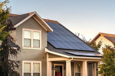 Solar photovoltaic panels on a house roo
