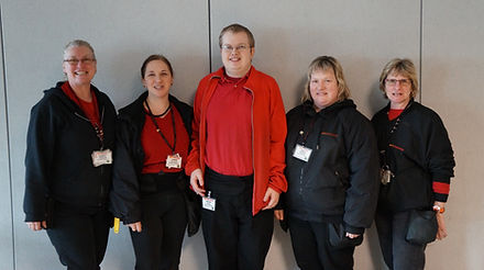 Alt=AHEDD Participant Jeromy standing with four female teammates from AutoZone