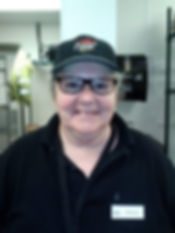 Alt=AHEDD Participant Carolyn, standing straight at the camera smiling in her Pizza Hut uniform
