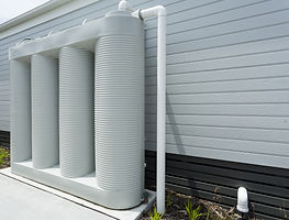 Rainwater collection tank besides a mode
