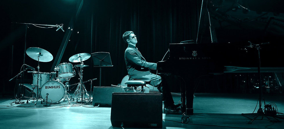 Justin playing solo on grand piano.  Bimhuis on drums.  Photo by Brigette Soffner, Amsterdam