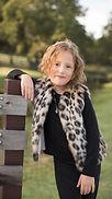 Little girls hip length vest in faux leopard fur