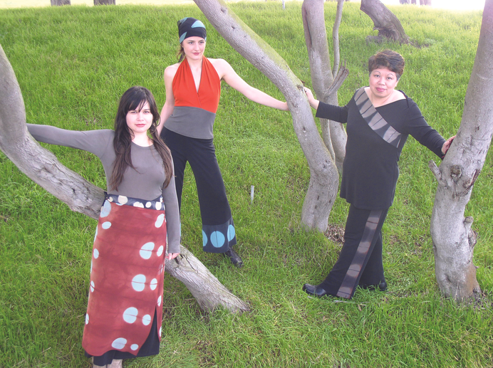 3 seamstresses modelling in trees