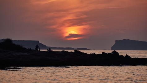 Sol entre Isla de Bocs y Isla Conejera
