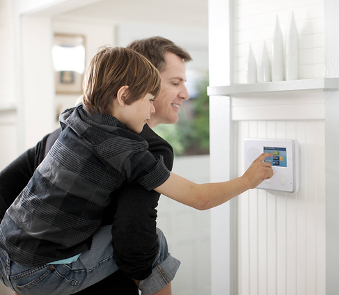 A family in a safe home using a intercom system.