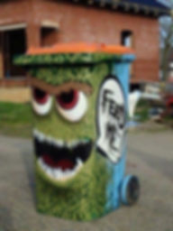 Trash Can wit Monser Painted on it