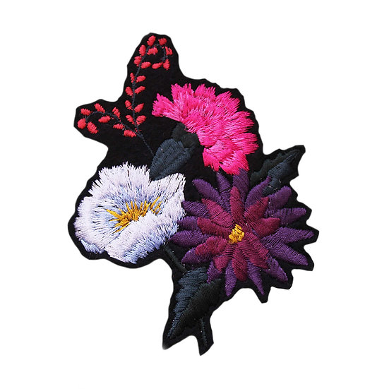 Embroidered floral bouquet with a carnation, dahlia and blue flowers on a black felt ground