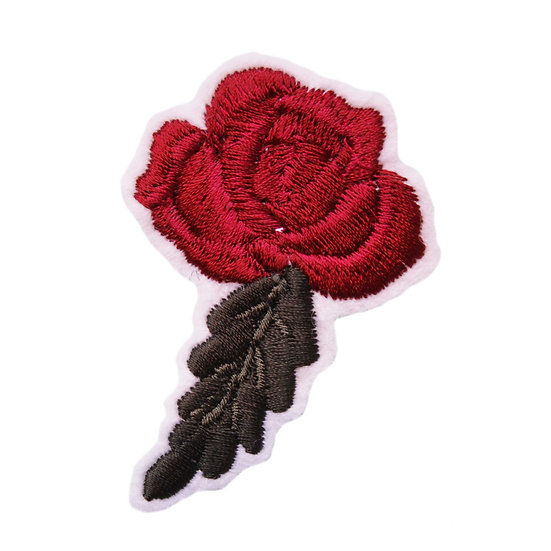 A small embroidered red rose bloom with a green leaf