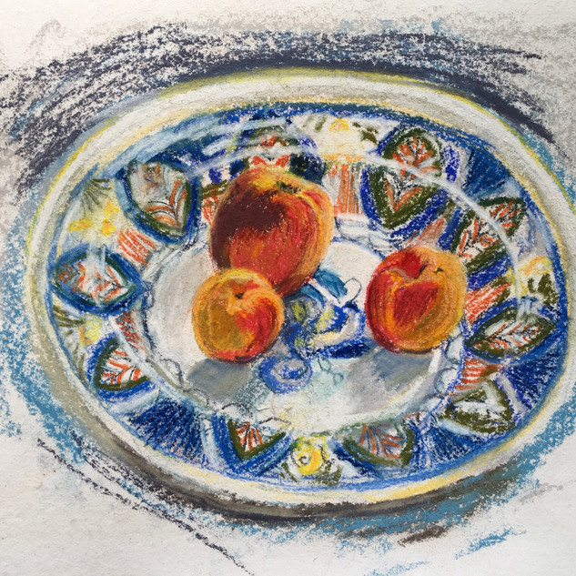 peach and apricots on the Spanish dish