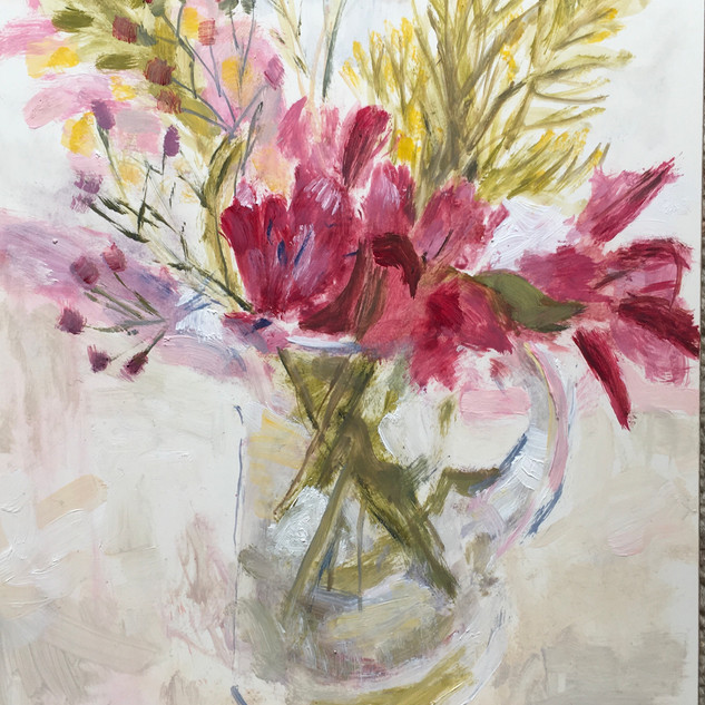 Flowers in small glass jug