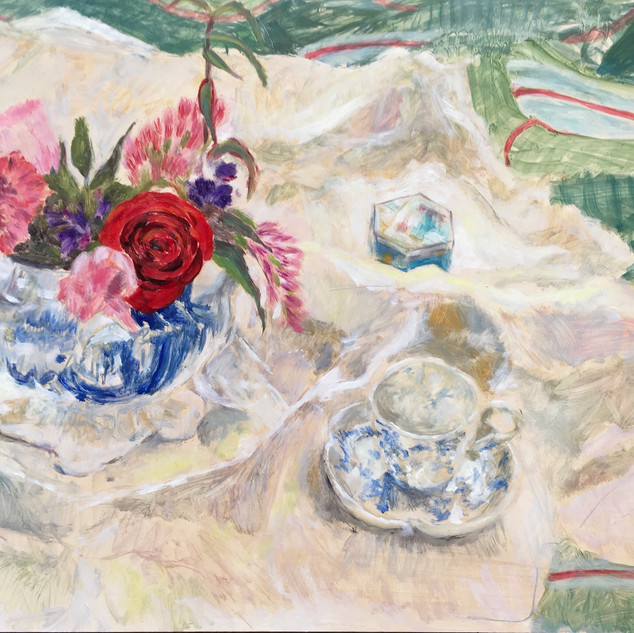 flowers in decorated bowl with chinese cup and saucer