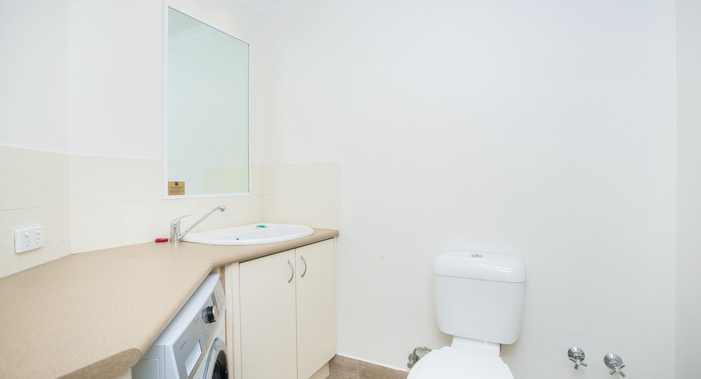 12. Laundry One Bedroom Penthouse Apartm