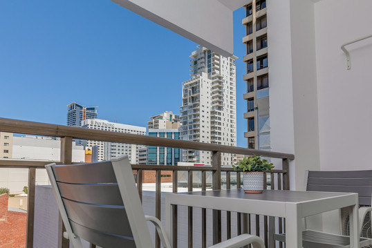 Balcony View Tables and Chairs - Short Term Rental Perth CBD