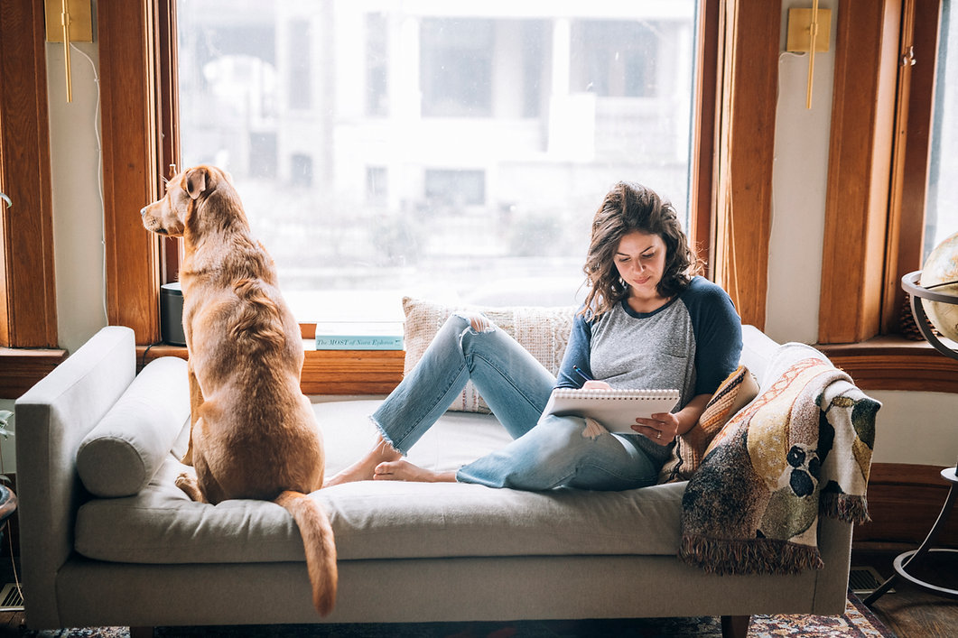 Woman drawing dog
