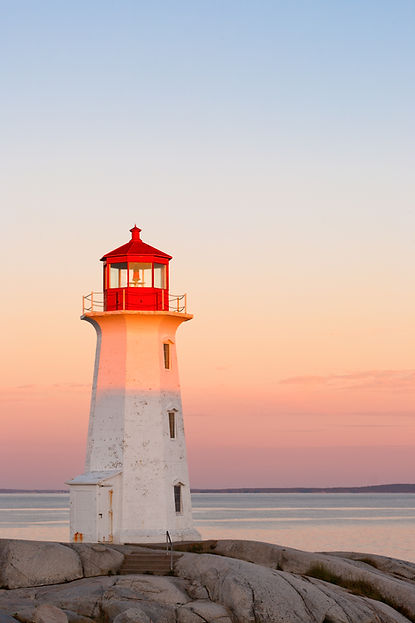Lighthouse by the Sea at Sunset