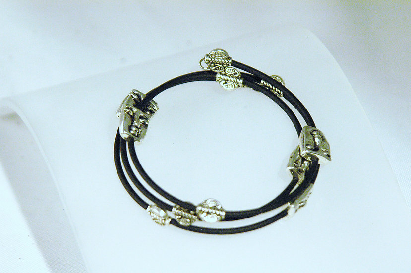 Bracelet wrapped w black rubber and silver beads