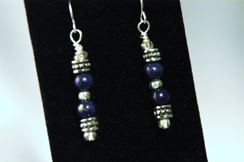 Silver tone earrings with blue lapis beads