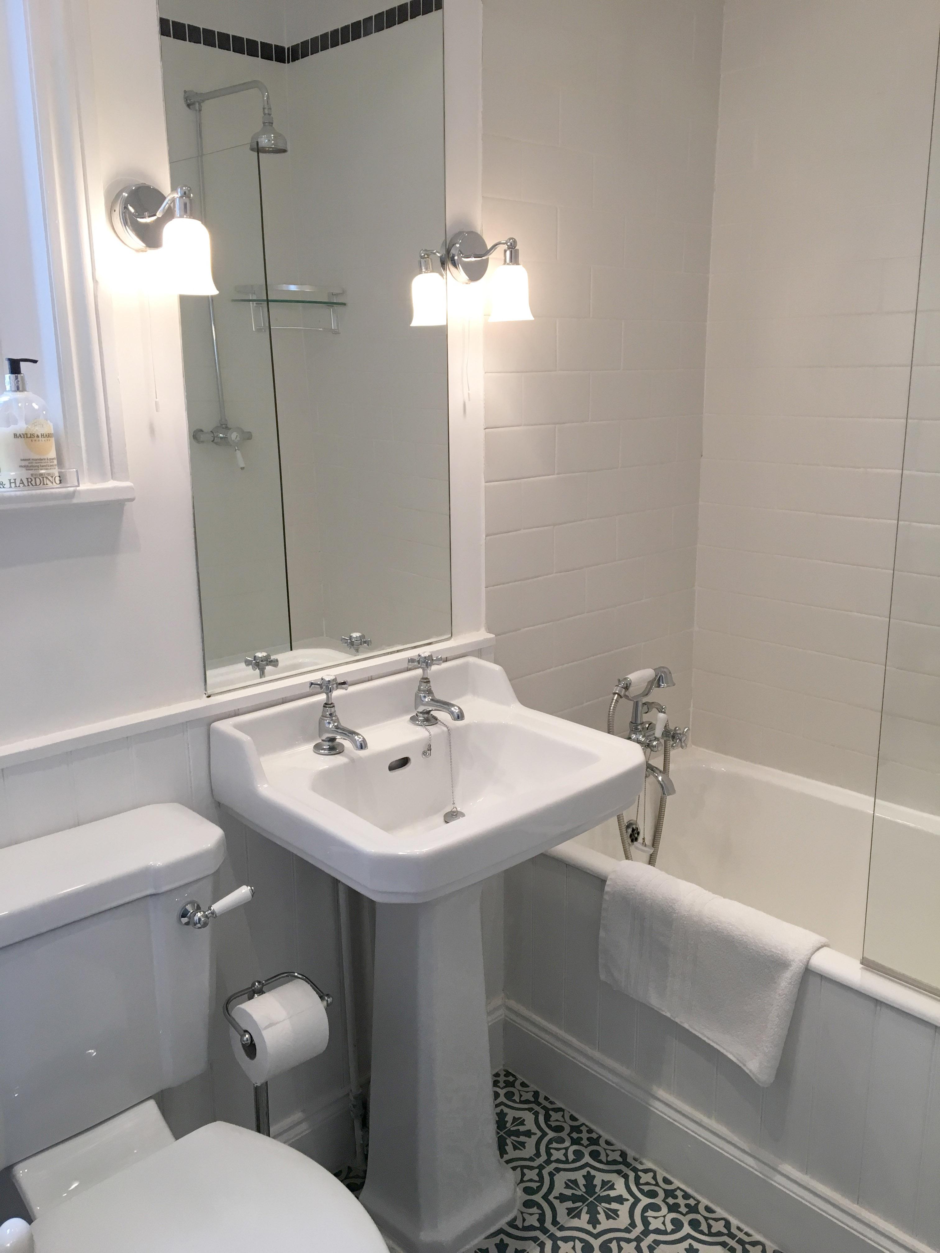 Main bathroom with overhead shower