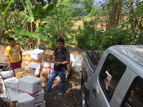 Julio and his son delivering medication