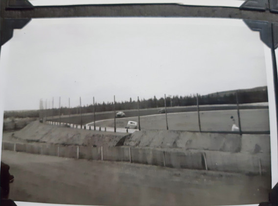 Note the flagman on the track surface during the race