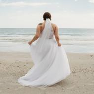Bride dancing at Upham Beach in St Petersburg Florida Elopement