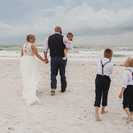 Family walking after wedding at Pass-a-Grille Beach