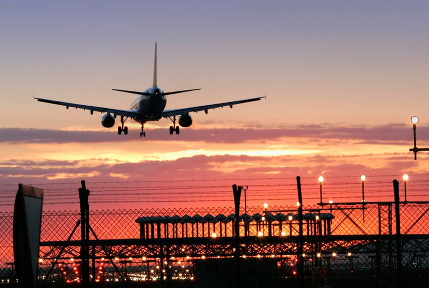 AirplaneLandingAirportSunset.jpg