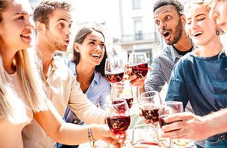 Happy multiracial friends having fun dri