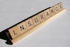 Scrabble letters spelling insurance