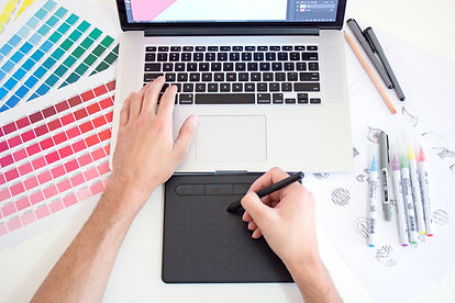 Designer working with a digital tablet and color swatches.