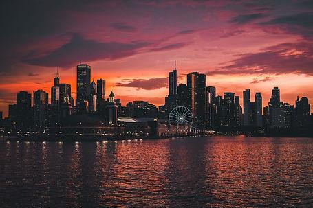 buildings-by-lake-against-sky-at-dusk-ro