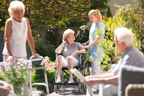 Senior woman in wheelchair spending time