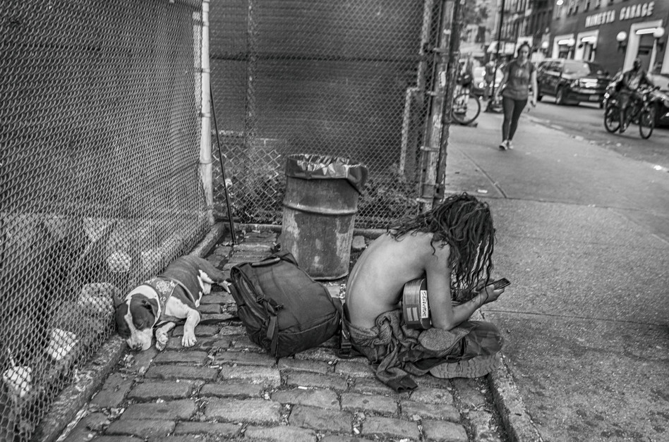 Homeless youth with his dog in Greenwich