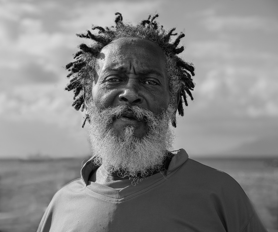 Old man on the beach in Nevis