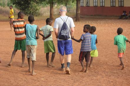 Wes walks away with kids.JPG