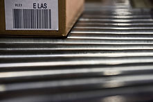 close-up-of-shipping-labels-with-bar-codes-on-card-5TXV33N.jpg