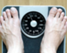 Hypnotherapy for Weight Loss in Stirling - Person Weighing Themselves