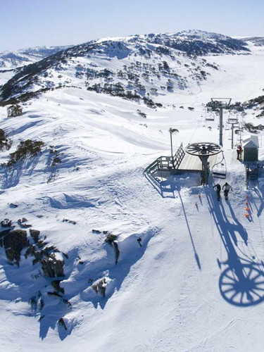 Skiing at snowy mountains