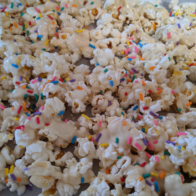 adding sprinkles to popcorn.jpg