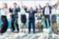 Diversity business team jumping celebrat