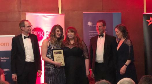 The finalists of the Best Probate Research Paralegal on stage at the National Paralegal Awards 2019 as winner, Lauren Geary, collects her award.