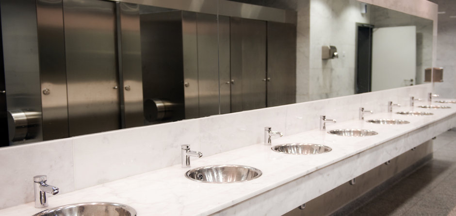 Public empty restroom with washstands mi