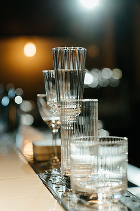 clear-wine-glasses-on-brown-wooden-table