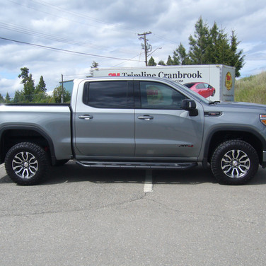 35% Medium Tint on Fronts. This can get you a ticket in BC. 20% over factory tint on rear.