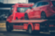 Red Broken Car on a Red Towing Truck. Cl