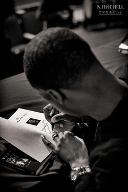 bryan_signing_book_01_black_and_white