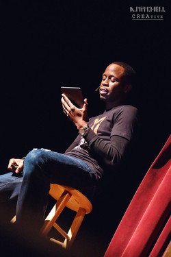 bryan_performing_a_reading