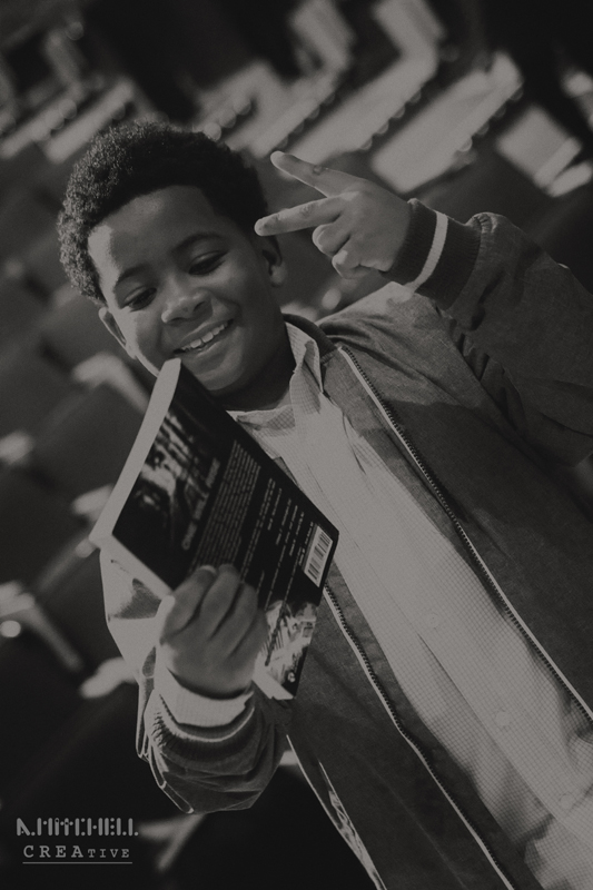 boy_looking_at_book_black_and_white