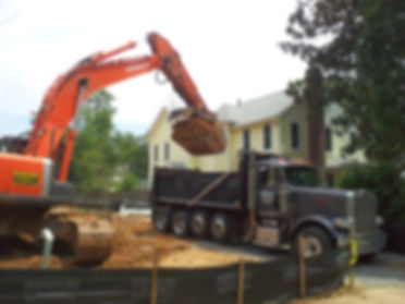 Our excavator loading a dumptruck in Falls Church, VA.