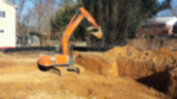Our excavator digging a basement in McLean, VA.